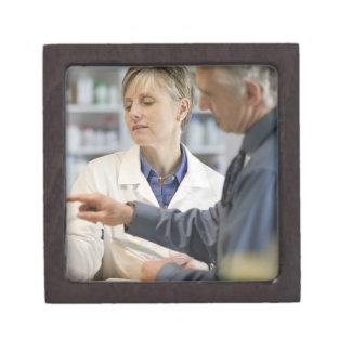 Pharmacist helping customer with medicine gift box