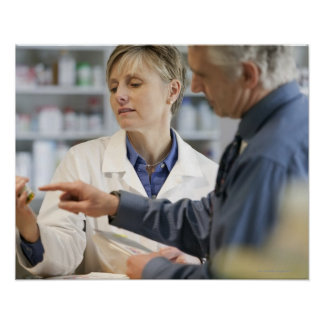 Pharmacist helping customer with medicine posters