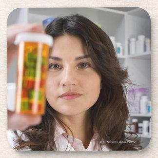 Pharmacist holding a pill bottle coaster