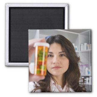 Pharmacist holding a pill bottle fridge magnet