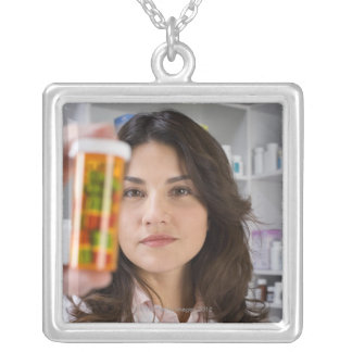 Pharmacist holding a pill bottle silver plated necklace