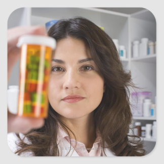 Pharmacist holding a pill bottle square sticker