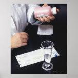 Pharmacist holding medicine bottle, close-up, poster