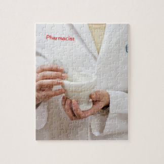 Pharmacist holding mortar and pestle jigsaw puzzle