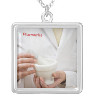 Pharmacist holding mortar and pestle silver plated necklace