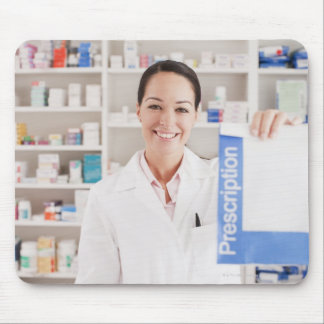 Pharmacist holding prescription in drug store mouse pad