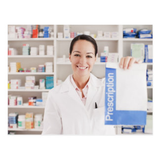 Pharmacist holding prescription in drug store postcard