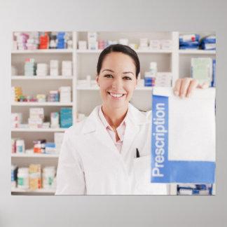 Pharmacist holding prescription in drug store poster