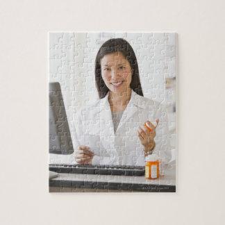 Pharmacist holding prescription medication jigsaw puzzle