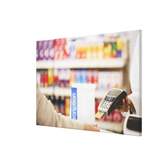 Pharmacist holding security device for customer canvas print