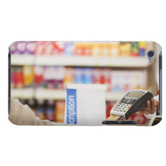Pharmacist holding security device for customer iPod touch covers