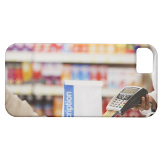 Pharmacist holding security device for customer iPhone SE/5/5s case