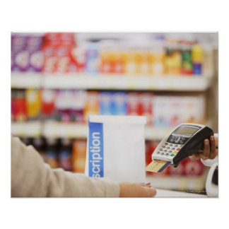 Pharmacist holding security device for customer poster