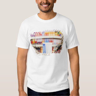 Pharmacist holding security device for customer t shirt