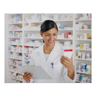 Pharmacist in drug store holding clipboard poster