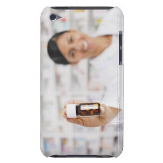 Pharmacist in drug store holding out pill bottle iPod Case-Mate case