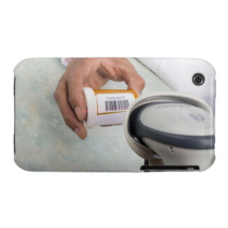 Pharmacist scanning pill bottle with a barcode iPhone 3 Case-Mate case