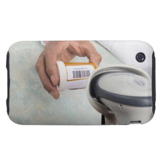 Pharmacist scanning pill bottle with a barcode iPhone 3 tough covers