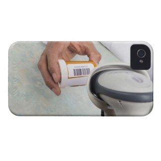 Pharmacist scanning pill bottle with a barcode iPhone 4 Case-Mate case