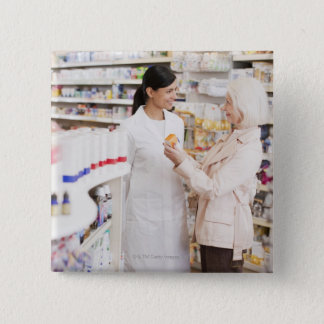 Pharmacist talking to customer in drug store button
