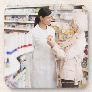 Pharmacist talking to customer in drug store drink coaster