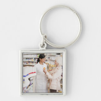 Pharmacist talking to customer in drug store Silver-Colored square keychain