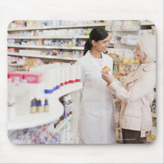 Pharmacist talking to customer in drug store mouse pad