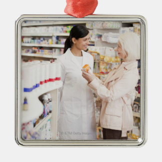 Pharmacist talking to customer in drug store square metal christmas ornament