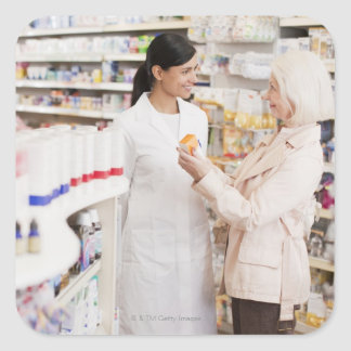 Pharmacist talking to customer in drug store square sticker