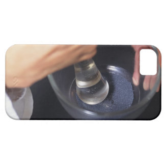 Pharmacist using mortar and pestle on table, iPhone 5 cover