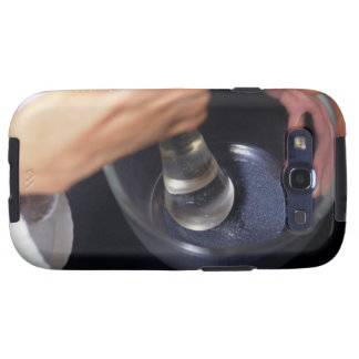 Pharmacist using mortar and pestle on table, samsung galaxy s3 case
