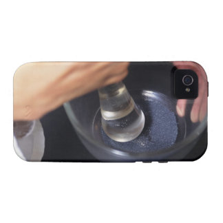 Pharmacist using mortar and pestle on table, vibe iPhone 4 case