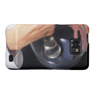 Pharmacist using mortar and pestle on table samsung galaxy s case