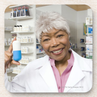 Pharmacist with giant pill beverage coaster