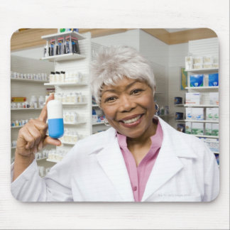 Pharmacist with giant pill mouse pad