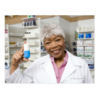 Pharmacist with giant pill postcard