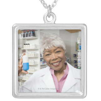 Pharmacist with giant pill silver plated necklace
