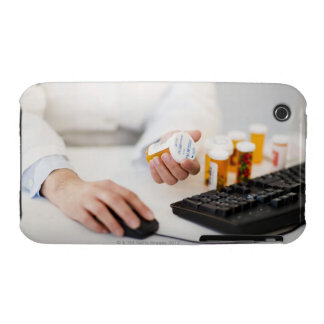 Pharmacist with pill bottles at computer iPhone 3 Case-Mate case