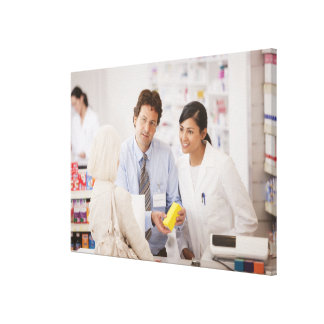 Pharmacists answering questions for customer in canvas print