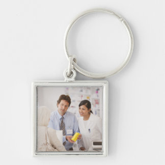 Pharmacists answering questions for customer in keychain