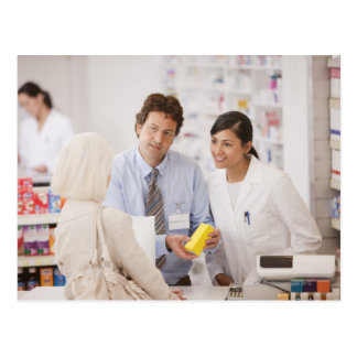 Pharmacists answering questions for customer in postcard