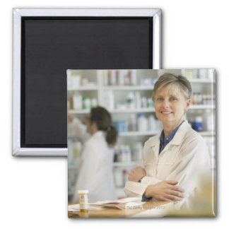 Pharmacists at counter of retail pharmacy magnet