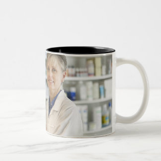 Pharmacists at counter of retail pharmacy Two-Tone coffee mug