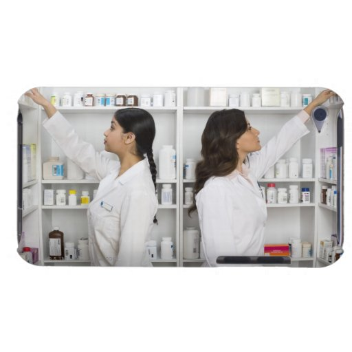 Pharmacists reaching for medication on shelves iPod touch covers