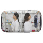 Pharmacists reaching for medication on shelves samsung galaxy s3 case