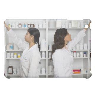 Pharmacists reaching for medication on shelves iPad mini case