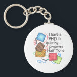 "PHD In Quilting Keychain<br><div class=""desc"">Quilting is such a special talent that requires time patience.  Give this quilting bug design to them.  They will love it!</div>"