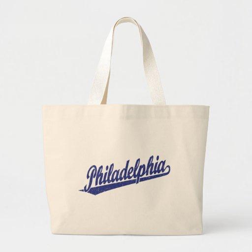 Philadelphia script logo in blue distressed bags