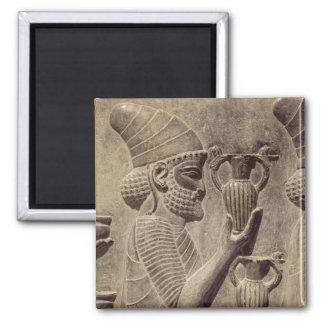 Phoenician que lleva dos que ofrecen, alivio del d imán cuadrado