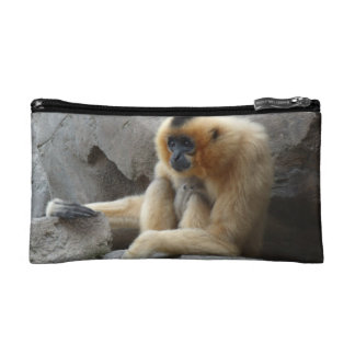Photo of Orange and Black Gibbon Relaxing on Cliff Cosmetic Bag